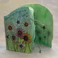 'Sissinghurst Gardens Journal' mixed media with applied paper flowers, illustration and stitch (click to enlarge)