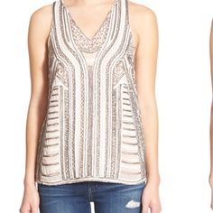 Stunning sequin tank top with sheer back. Beautiful tank from Nordstrom's. Not a single flaw, fits true to size. Sheer back, so would look best without a bra if you don't want a strap showing. I removed the tags so I can't return it, it's a little big for me  Storee Tops Tank Tops