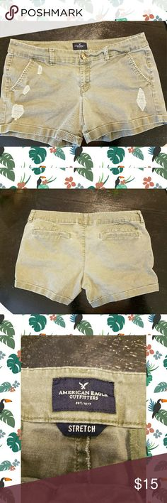 American Eagle Army Green Midi Shorts Distressed army green stretch midi-length shorts. Super comfy. I love these shorts, they just don't fit me anymore. Good condition. American Eagle Outfitters Shorts
