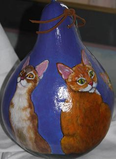 Natural gourd birdhouse with cats painted all around the outside. This was one of the first gourds I painted. Visit RachelArmington.com for more gourd creations.