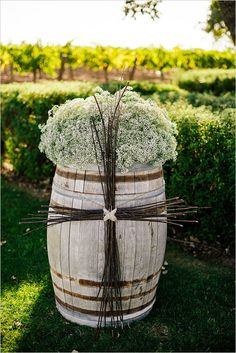 wine barrel and babys breath decor #weddingceremony #weddingdecor #weddingchicks http://www.weddingchicks.com/2014/03/17/shabby-chic-winery-wedding/