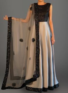 Features a sequins bust alongside a taffeta silk flare, santoon inner and bottom alongside an embroidered net dupatta.