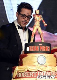 Take it down to two layers with the same classy design and Iron Man on top.  Too bad Robert Downey Jr won't come with it.