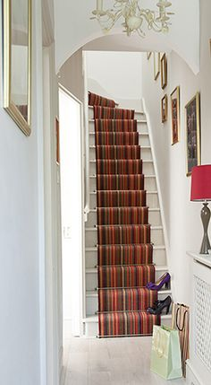 Let your hallway make an instant impression with a bold Color Net runner from expert Belgian carpet weavers Louis de Poortere. Staircase Carpet Runner, Stairway Carpet, Hall Carpet, Striped Carpet Stairs, Striped Carpets, Staircase Design Modern, Hallway Designs, Hallway Ideas, Narrow Hallway Decorating