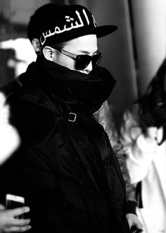 G-Dragon wearing cap with Arabic Words