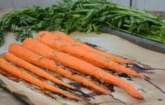 Maple Roasted Carrots. The perfect vegetarian side dish for a fall feast! It doesn't take much to turn a simple vegetable into a culinary masterpiece, and this recipe will do just that! Perfectly sweetened with maple syrup and topped off with fresh rosemary - we know you will fall in love with this dish. Healthy Thanksgiving Recipes, Vegetarian Side Dishes, Roasted Carrots, Meals, Vegetables, Sweet, Maple Syrup, Food, Dinner Ideas