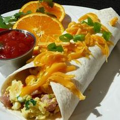 """Ham and Cheese Breakfast Tortillas - """"This is great for a special brunch or even a quick and easy dinner. Other breakfast meats can be used, but the deli ham is the easiest since it is already fully cooked. Breakfast Tortilla, Breakfast Wraps, What's For Breakfast, Breakfast Items, Breakfast Dishes, Breakfast Recipes, Mexican Breakfast, Breakfast Sandwiches, Christmas Breakfast"""