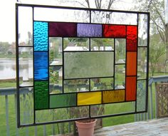 Stained glass panel with rainbow and bevels