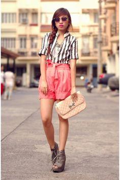 Stripes, sunglasses, paper bag shorts, clutch, wedges.