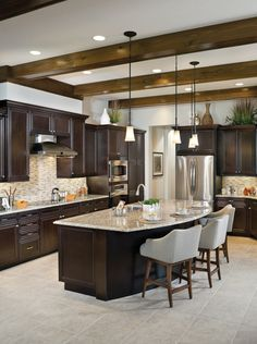 Rutenberg Lakeland Luxury Designer Home - Rustic kitchen with dark ceiling beams - island with counter seating Kitchen Island With Seating, Diy Kitchen Island, Kitchen Redo, Rustic Kitchen, New Kitchen, Kitchen Remodel, Kitchen Tile, Room Kitchen, Ranch Kitchen