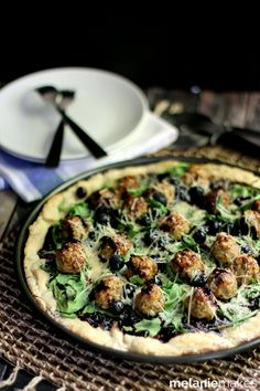 Say good-bye to your typical pie and say hello to this Blueberry Balsamic Chicken Meatball Pizza.  An easy homemade crust and from scratch chicken meatballs star alongside baby arugula, blueberries and Parmesan on this one of a kind pizza.