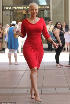 Red hot: Amber Rose displays her womanly figure in a fitted red frock as she promoted new film School Dance in NYC on Wednesday