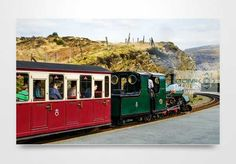 Hunslet 0-4-0ST narrow gauge steam loco Blanche at Tanygrisiau railway station on the Ffestiniog steam railway. Available in sizes from 12″ x 8″ to 30″ x 20″ (larger by arrangement). Your wall art print can be finished as a canvas, metal, wooden block or acrylic block prints