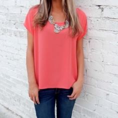 Coral top! Gorgeous coral top! Brand new never worn! It was too big for me! Ordered from a boutique! Tops