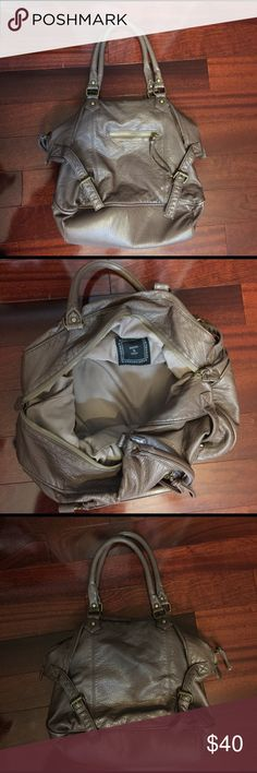 UO SHOULDER BAG In great condition! Brown bag with a small zipper  pocket in the front and another zipper pocket inside with two other small pockets Urban Outfitters Bags Shoulder Bags