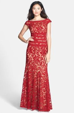 Free shipping and returns on Tadashi Shoji Textured Lace Mermaid Gown at Nordstrom.com. Elaborate, textured lace fashions a stately, bateau-neckline gown highlighted with bold stripes around the waist and a subtly flared skirt that enhances the powerfully feminine silhouette.