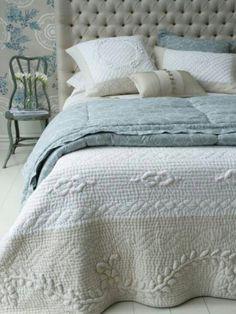 Tan, cream, and blue green bedding