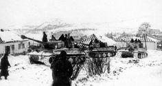 German Panzerkampfwagen VI Tiger Ausf. E heavy tanks advance through the village of Buki, Ukraine, 1944.