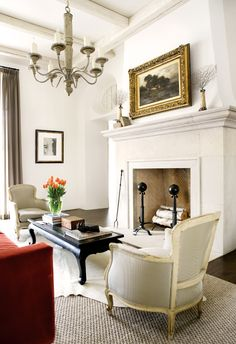 Google Image Result for http://eclecticrevisited.files.wordpress.com/2011/03/living-room-decorating-white-traditional-transitional-designs-french-chairs-black-coffee-table-fireplace-eclectic-home-decor-ideas.jpg