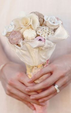 Just can NOT get enough of these!  Here's another awesome door knob wedding bouquet in creams and pinks.  So pretty!  vintage wedding. wedding ideas. wedding bouquet. door knobs. rustic wedding. unique wedding ideas.