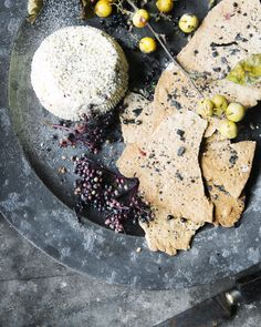 Fire roasted goat cheese with crackers and ash salt lens and larder Ireland - Suech and Beck