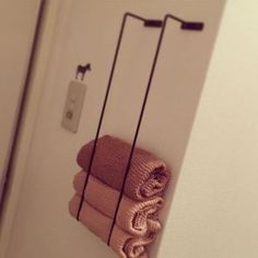 Love this idea...Japanese towel rack hack. Hang them vertically to store bathroom towels. genius!