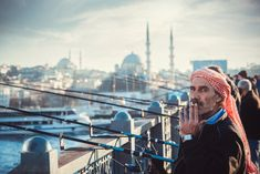 A Syrian fisherman smoking while fishing at the Golden Horn Bridge. Golden Horn, Secret Service, Mosque, Fine Art Photography, Istanbul, Egypt, Smoking, My Photos, Bridge