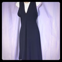 """Carolina Herrera LBD FINAL REDUCTION 💥💥 Carolina Herrera little black dress with criss crossing straps . Knit stretch fabric pull on size 10. Bust one side 16 1/2"""", length from shoulders 40. Great tailoring, timeless dress Carolina Herrera Dresses"""