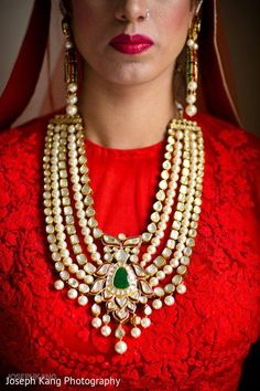 Get your layering game on point with an ostentatious five tier jadau and pearl necklace.