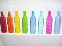 Colorful Tall Glass Bottles Red Orange Yellow Green Blue Aqua Pink Teal Navy Wedding Centerpieces Flowers. $5.00, via Etsy.  Centro de mesa  boda