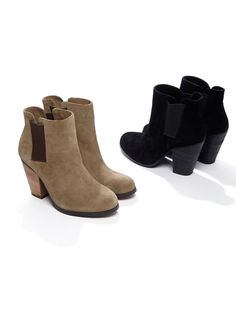 Genuine suede booties with a stacked heel and elastic side bands for an easy on-and-off.