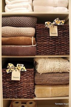 Organize your linen closet with baskets like this one from Turnstyle Voguere. I love the way they act as a divider/stackers and decorative organization.