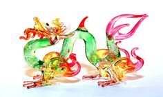 Glass Animal Figurine: a handmade magical dragon figurine.  Lampworked boro glass collectible. Green / red colors.. $12.00, via Etsy.