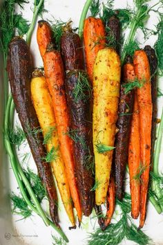 Turmeric Roasted Carrots Recipe | The Mediterranean Dish. A simple side dish of whole roasted carrots prepared the Mediterranean way w/ olive oil, lime juice, garlic and spices like turmeric and cinnamon. A healthy and easy side dish that wins every time! See it on TheMediterraneanDish.com Veggie Side Dishes, Vegetable Dishes, Side Dish Recipes, Vegetable Recipes, Vegetarian Recipes, Turmeric Recipes, Carrot Recipes, Mediterranean Dishes, Mediterranean Diet Recipes