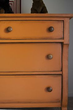 love the antique look of this dresser - don't love that she turned a tiger oak dresser into this but it would be great with a crappy old relic