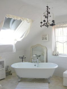 under the eaves bathroom~subway tiles, white with a black chandelier~