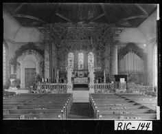 1915.; Interior shot of St. Paul's Episcopal Church on Reynolds Street decorated for Christmas. Augusta, GA