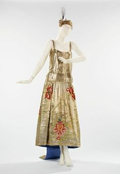 The classic perfume Arpege, by Lanvin, was launched in 1927, not long after this dress was created. (Gold lame gown by Lanvin, c. 1923. Brooklyn Costume Institute.)