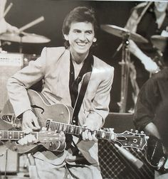 George Harrison (onstage during the Japan Tour in 1991)
