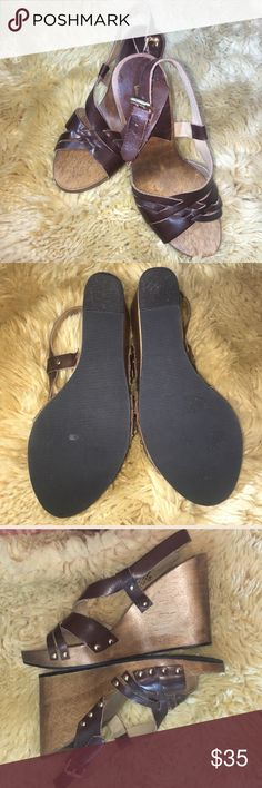 """Michael Kors Brown Leather Wedge Description   Nice sandals from Michael Kors  Size 8 M  Brown leather uppers  High wood wedge heel is 4.25""""  Brass studs   Excellent condition   Item does not come with box Michael Kors Shoes Wedges"""