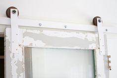DIY barn door hardware tutorial on the blog http://www.lynneknowlton.com/diy-door-track-hardware-its-dbomb-dot-com/
