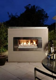Escea Outdoor Natural Gas Fireplace - Stainless Steel With White Ceramic Stones : BBQGuys Gel Fireplace, Natural Gas Fireplace, Outdoor Gas Fireplace, Outside Fireplace, Outdoor Walls, Outdoor Spaces, Contemporary Outdoor Fireplaces, Contemporary Fireplace Designs, Fire Pit Designs
