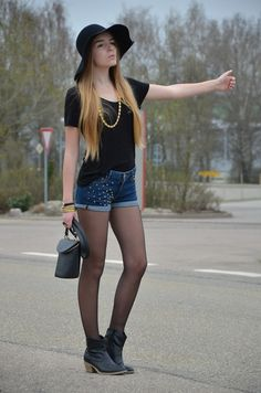 Black shirt and jean shorts with pantyhose and boots