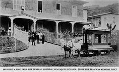 """Esta imagen data aproximadamente del año 1885. Observamos la salida de un cuerpo, desde el hospital """"general"""", hacia la carreta funeraria, tirada por dos burros, que lo espera en la entrada. Foto tomada en Guayaquil - Ecuador"""