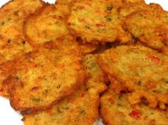 Saltfish Fritters Fritters are a main staple in Jamaican breakfast life. Many Jamaicans can relate to days of their childhoods when grandma or their moms usually get up early on especially a Saturday or Sunday morni… Haitian Food Recipes, Fish Recipes, Seafood Recipes, Indian Food Recipes, Cooking Recipes, Healthy Recipes, Ethnic Recipes, Recipies, Cooking Tips