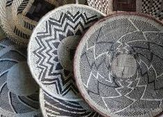 These African baskets are woven in Zambia and Zimbabwe from wild grasses and palm leaves. Beautiful as a wall display, traditionally these are winnowing baskets. Ethnic Decor, African Home Decor, Modern Crafts, Textiles, Curtain Designs, African Design, Baskets On Wall, Home Decor Inspiration, Decor Ideas