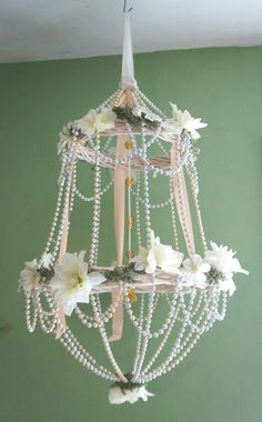 Make your own chandelier add lots of bling beads and crystals all from dollar store id do without the fake flowers though aloadofball Image collections