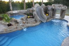 Fiberglass pool by Dolphin Pools of West Monroe Louisiana with Rico Rock waterfalls, kiddie pool, built in rock slide by Dolphin Water Slides, www. Big Pools, Luxury Swimming Pools, Luxury Pools, Dream Pools, Small Pools, Backyard Pool Landscaping, Backyard Pool Designs, Swimming Pools Backyard, Swimming Pool Designs