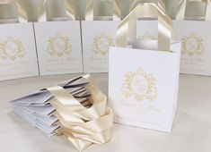 Monogram wedding welcome bags with champagne satin ribbon handles and custom initials, Elegant personalized gift bags for wedding favor for guests. #welcomebags #weddingwelcomebags #giftbags #personalizedgifts #weddingfavor #weddingfavors #weddingbags #weddingfavorideas #weddingparty #favorbags #weddingwelcome #elegantwedding #weddingmonogram #champagnewedding