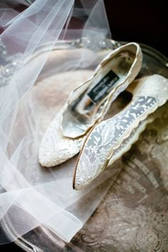 Detailed shot of Bride's lace wedding shoes on wedding day / Bridal veil / LEB is weekend wedding destination & barn event venue located in the Texas Hill Country / Photo: J. Violet Photography